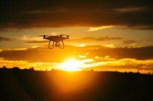 Dji drone flying in sunset