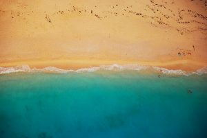 top down view of blue sea and beach