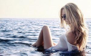 blonde sitting in the ocean