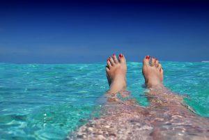 woman feet in water