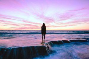 woman on sunset beach